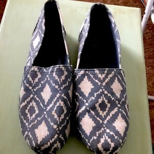 SO blue and white ikat patterned slip on shoes